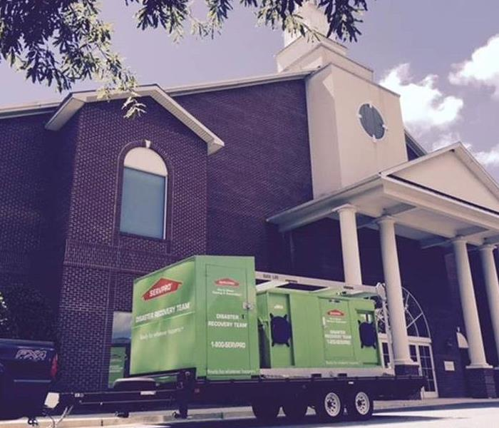 SERVPRO trucks and equipment in front of a school