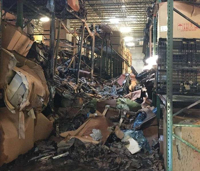 Burnt items on the ground after a fire in a warehouse