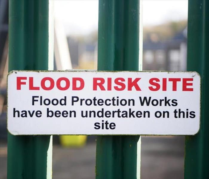 "Sign that says ""Flood Risk Site"""