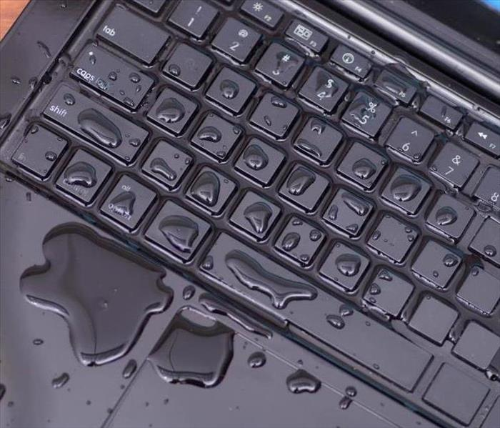 Water on keyboard of a computer
